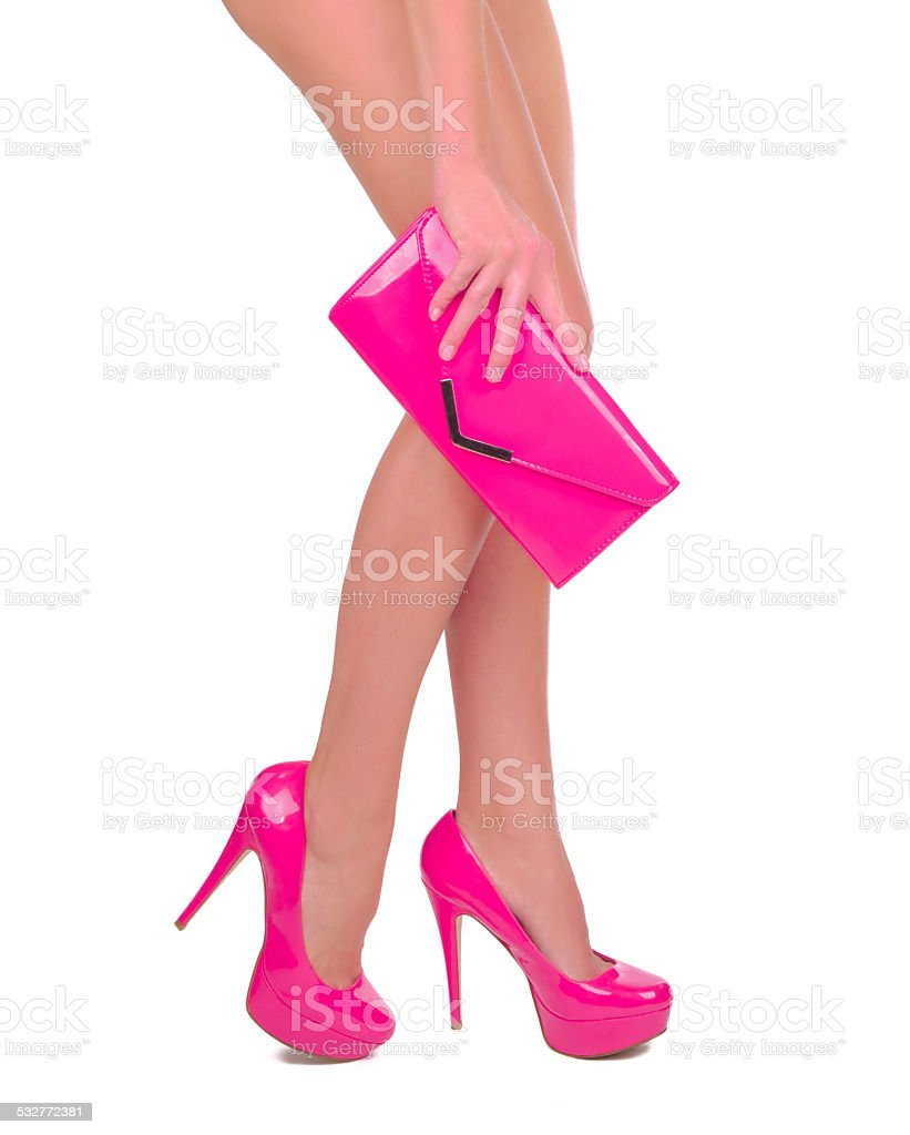Long legs with pink high heels stock photo