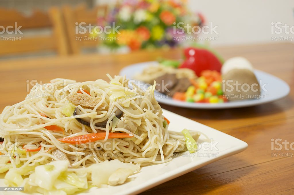 Long life noodle fried with colorful vegetable vegetarian food stock photo