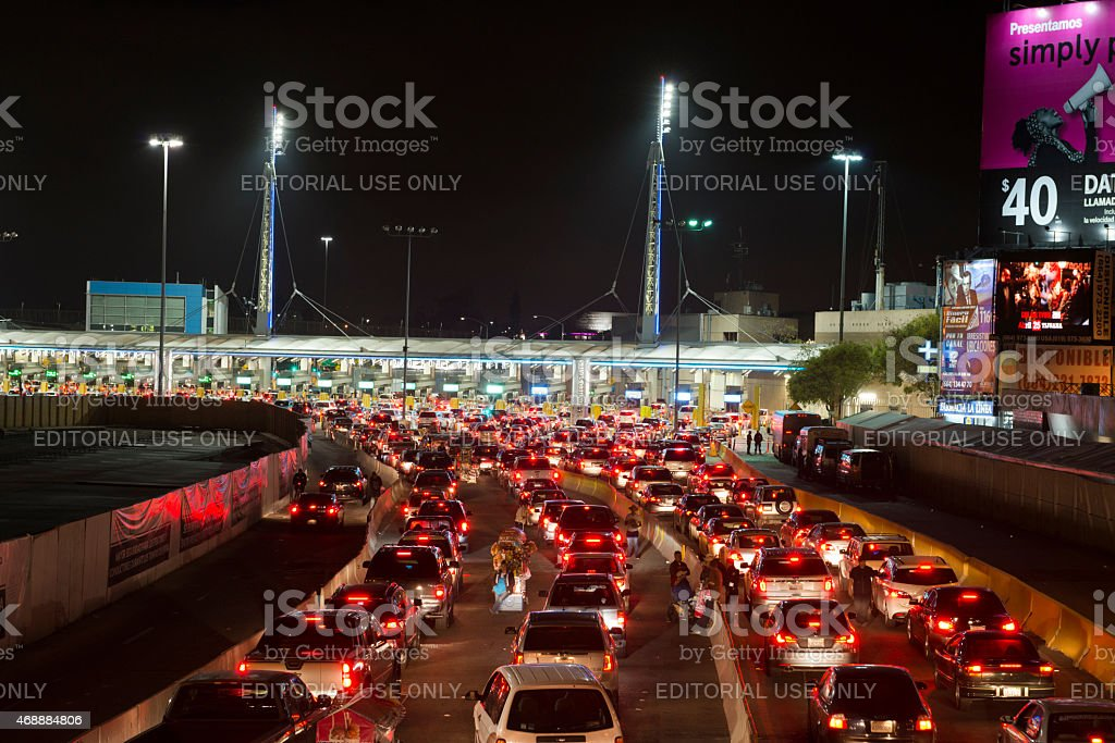 Long line of cars crossing Mexican border at Tijuana/San Ysidro stock photo