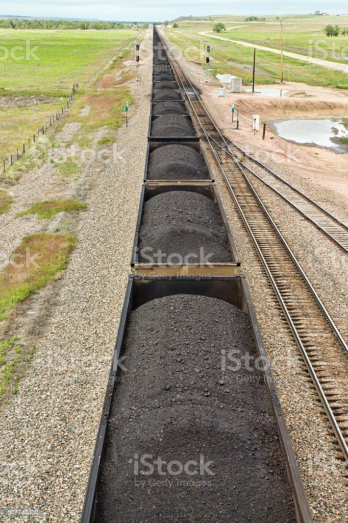 Long line of filled coal cars. stock photo