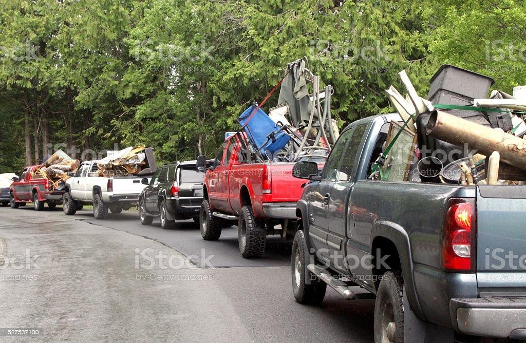 Long Line Up Of Trucks Heading For The City Dump stock photo