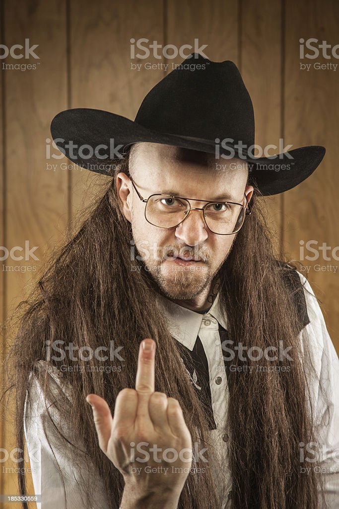 Long Mullet Redneck cowboy wood panelling middle finger royalty-free stock photo
