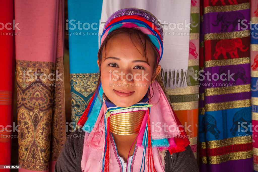 Long Neck woman in traditional costumes stock photo