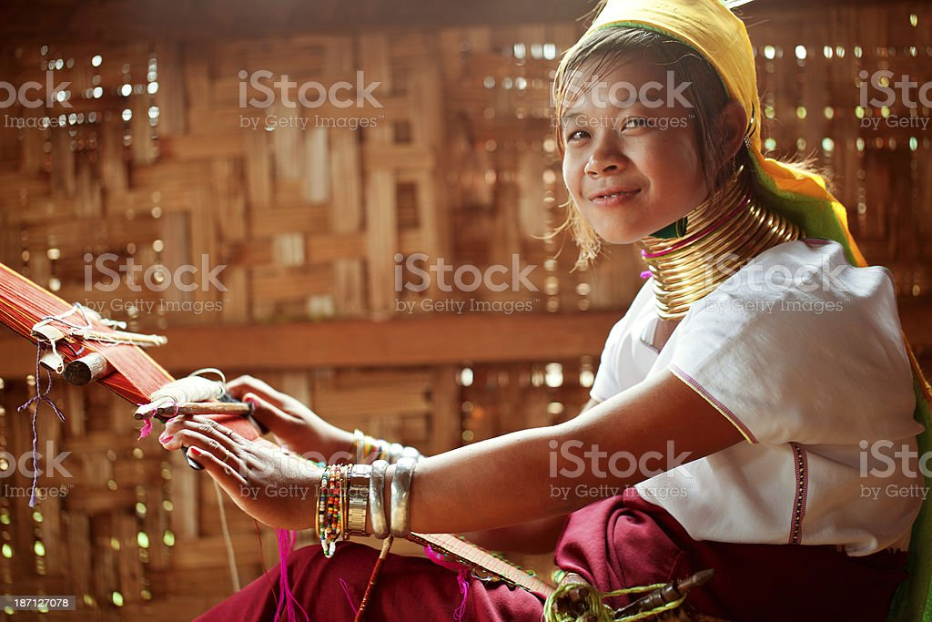 Long necked child engaged in manual work stock photo