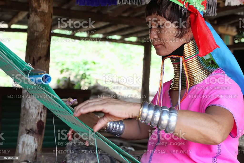 Long necked woman engaged in manual work royalty-free stock photo
