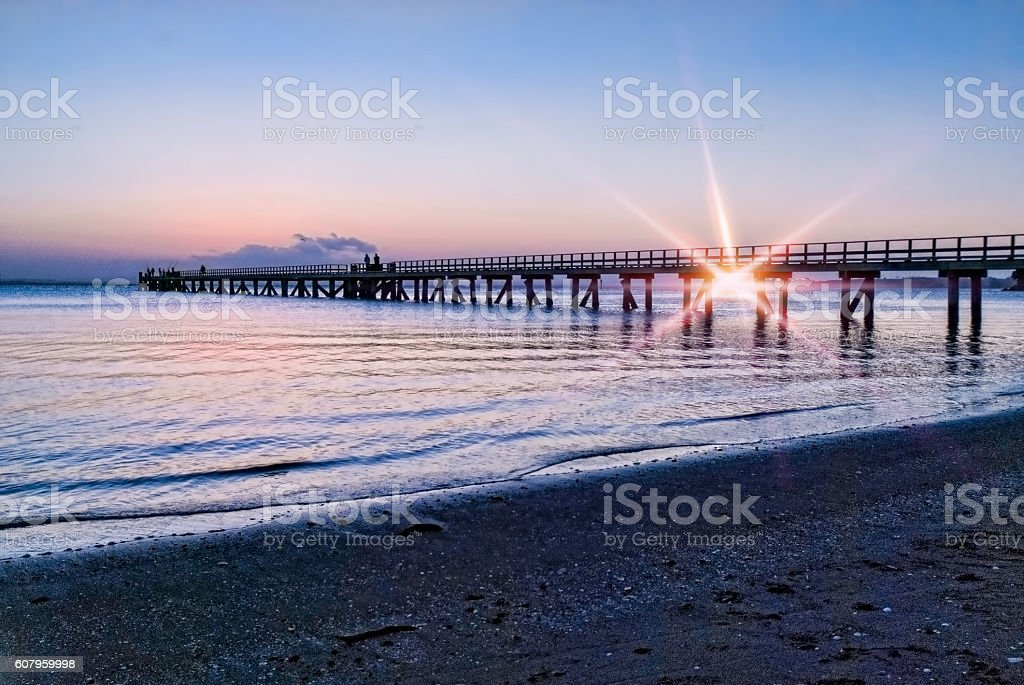 Long pier with flare stock photo