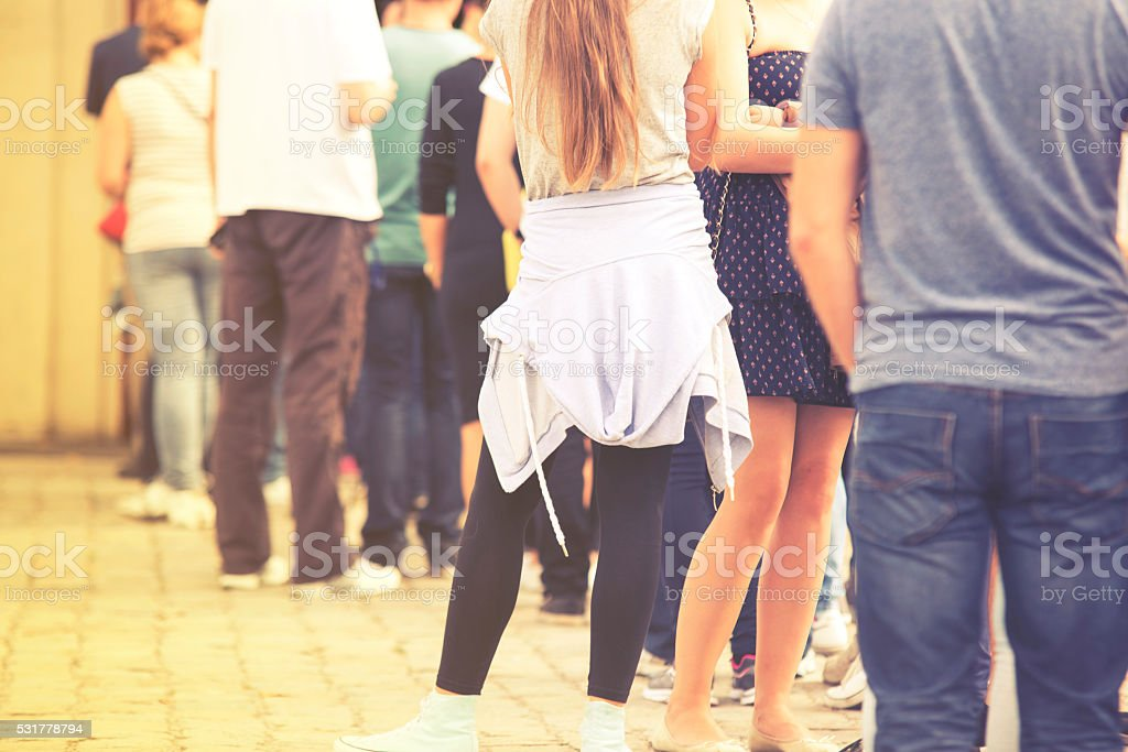 Long queue of people, vintage effect stock photo