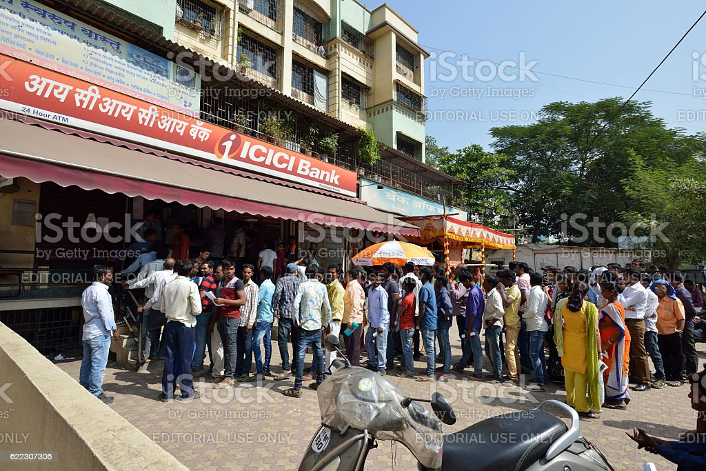 Long Queue Outside Bank to Withdraw New Indian Currency stock photo