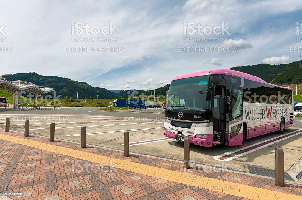 Long range bus at bus stop stock photo