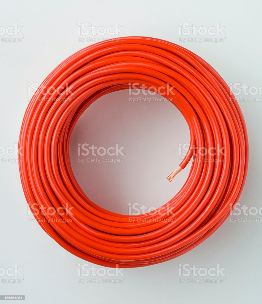 Long red coiled electrical cable royalty-free stock photo