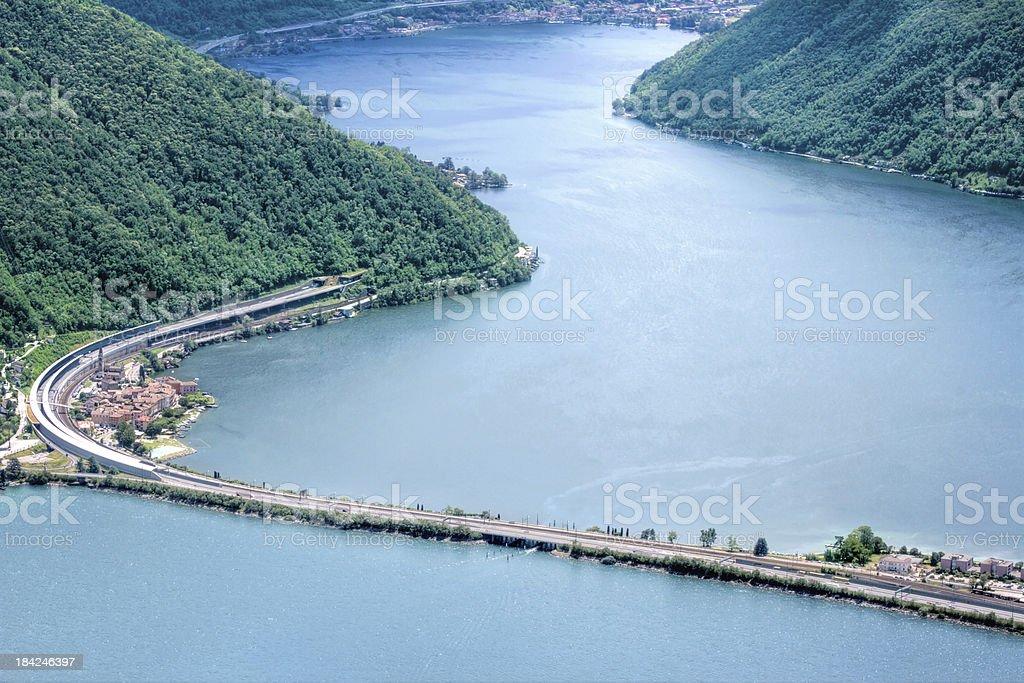 Long road crossing lake Lugano stock photo