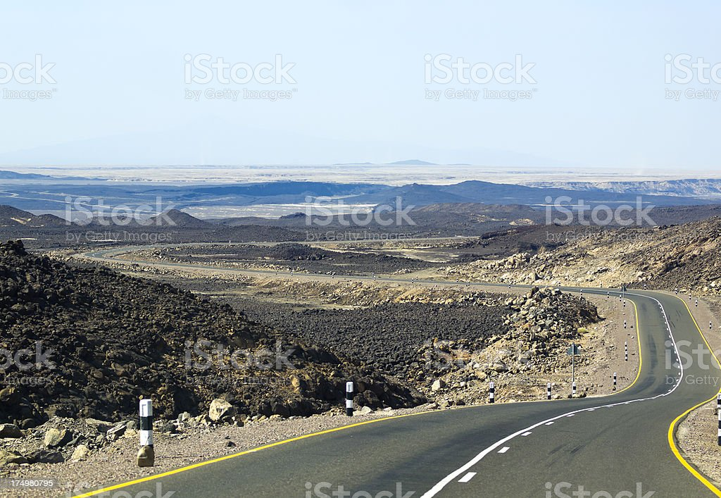 A long road leading to a desert. stock photo