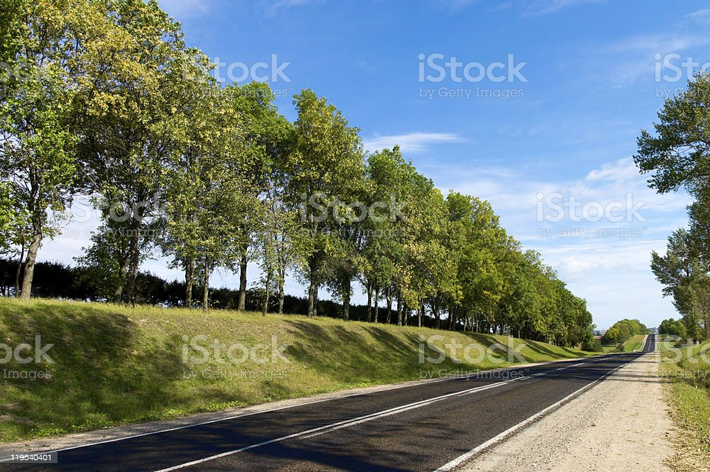 Long road to green hills. royalty-free stock photo