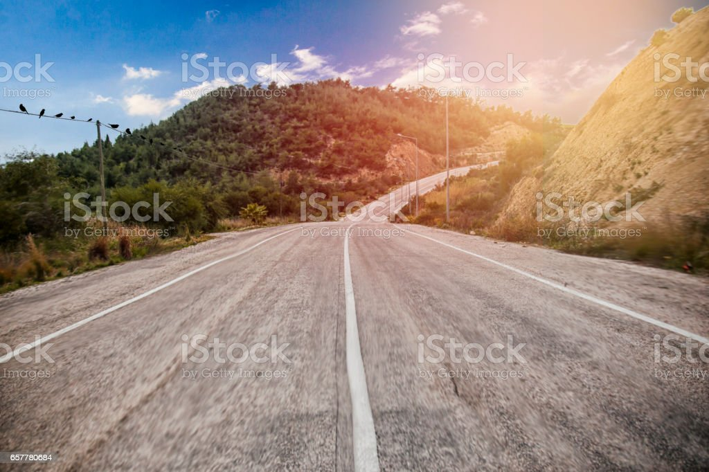 long road with sunset and birds stock photo