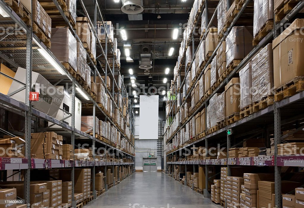 Long row of brown boxes on shelves in a warehouse stock photo