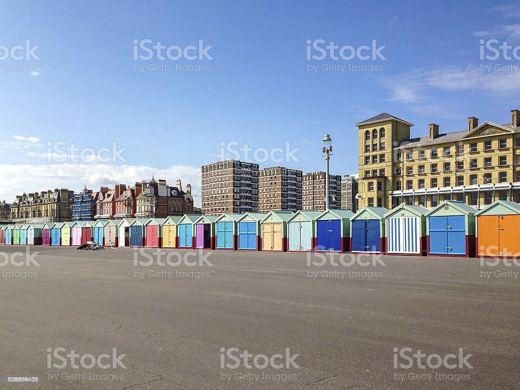 Long row of colourful beach huts stock photo