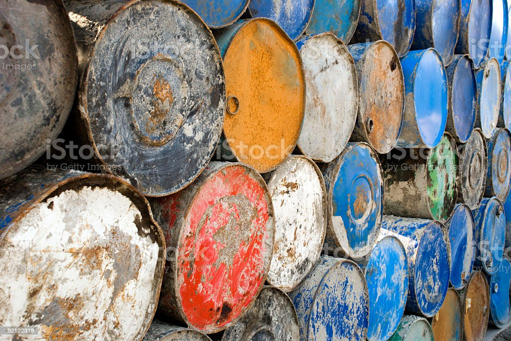 Long row of colourful metall barrels stock photo