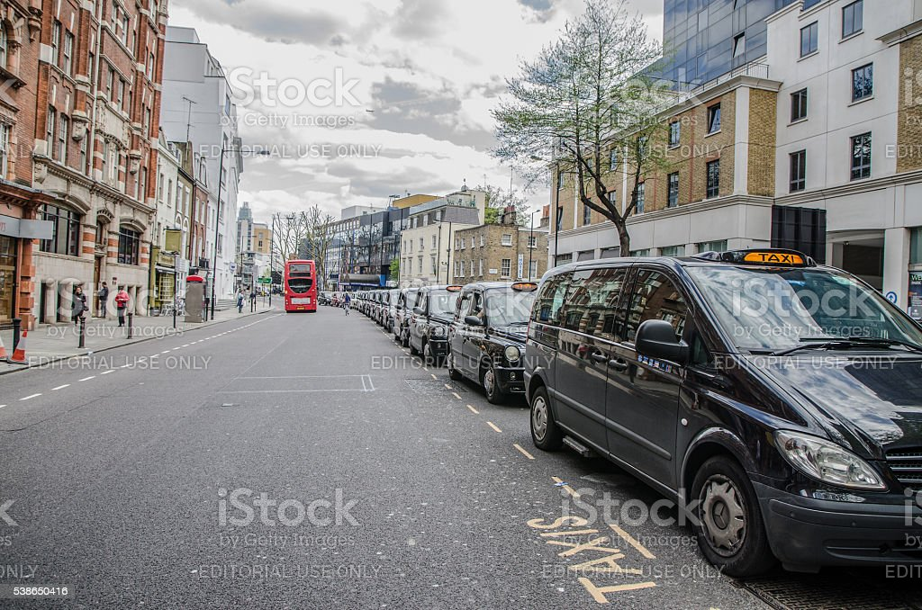 Long row of taxis waiting for a customer stock photo