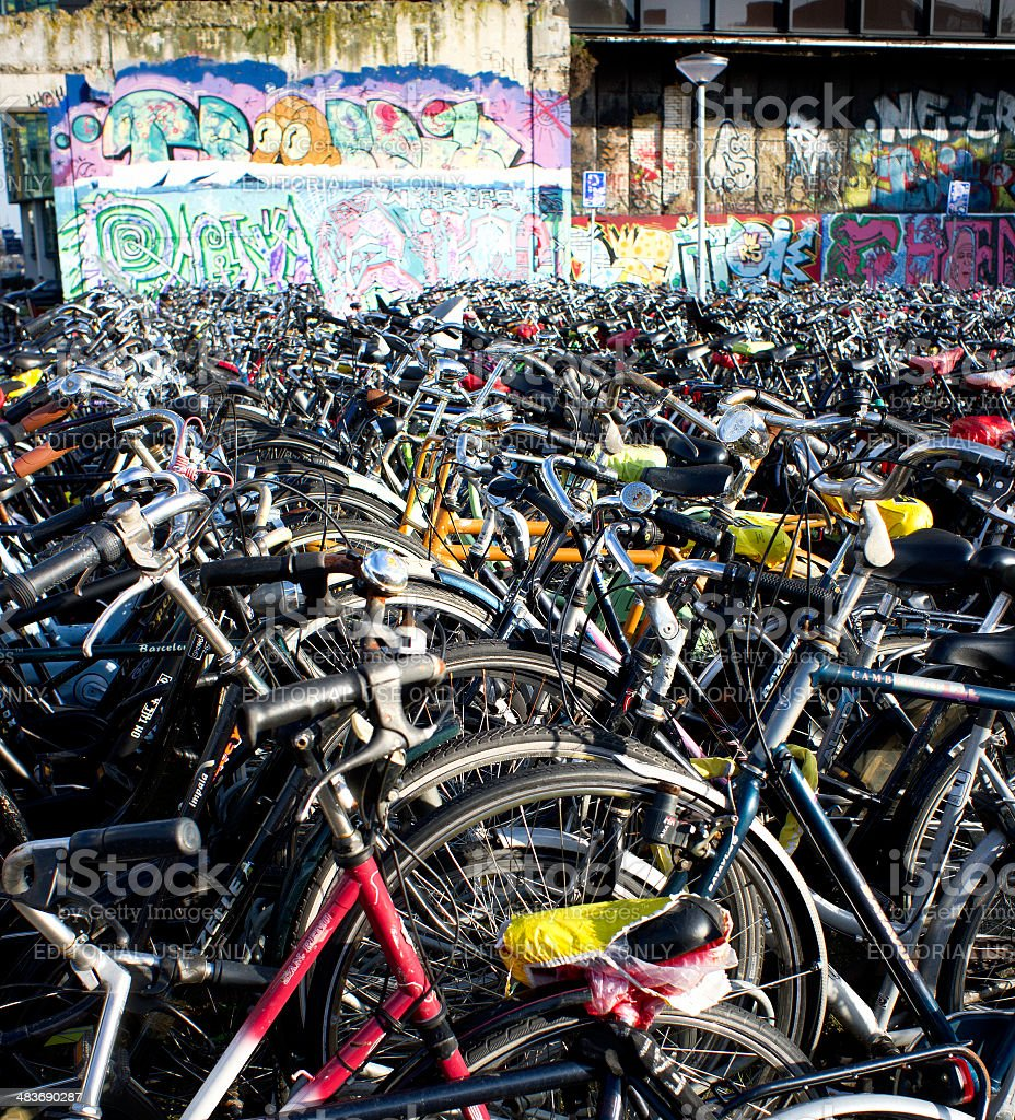 long rows of bicycles parked next to railroad station royalty-free stock photo