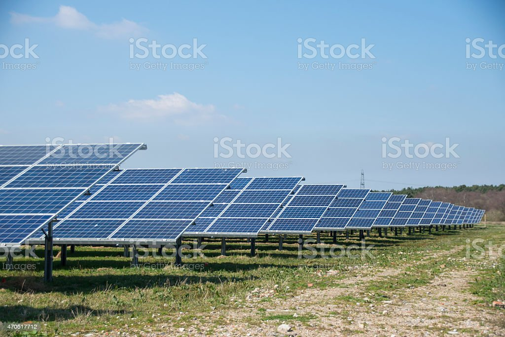 Long rows of solar panels in a Solar Park royalty-free stock photo