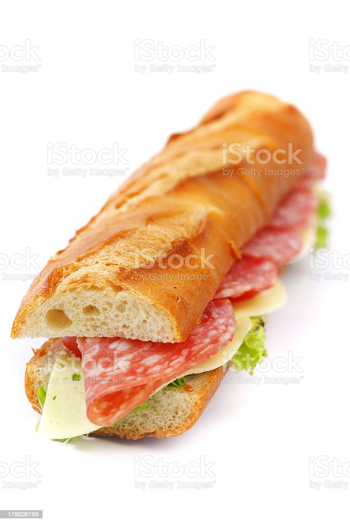 Long sandwich with  salami tomatoes isolated on white royalty-free stock photo