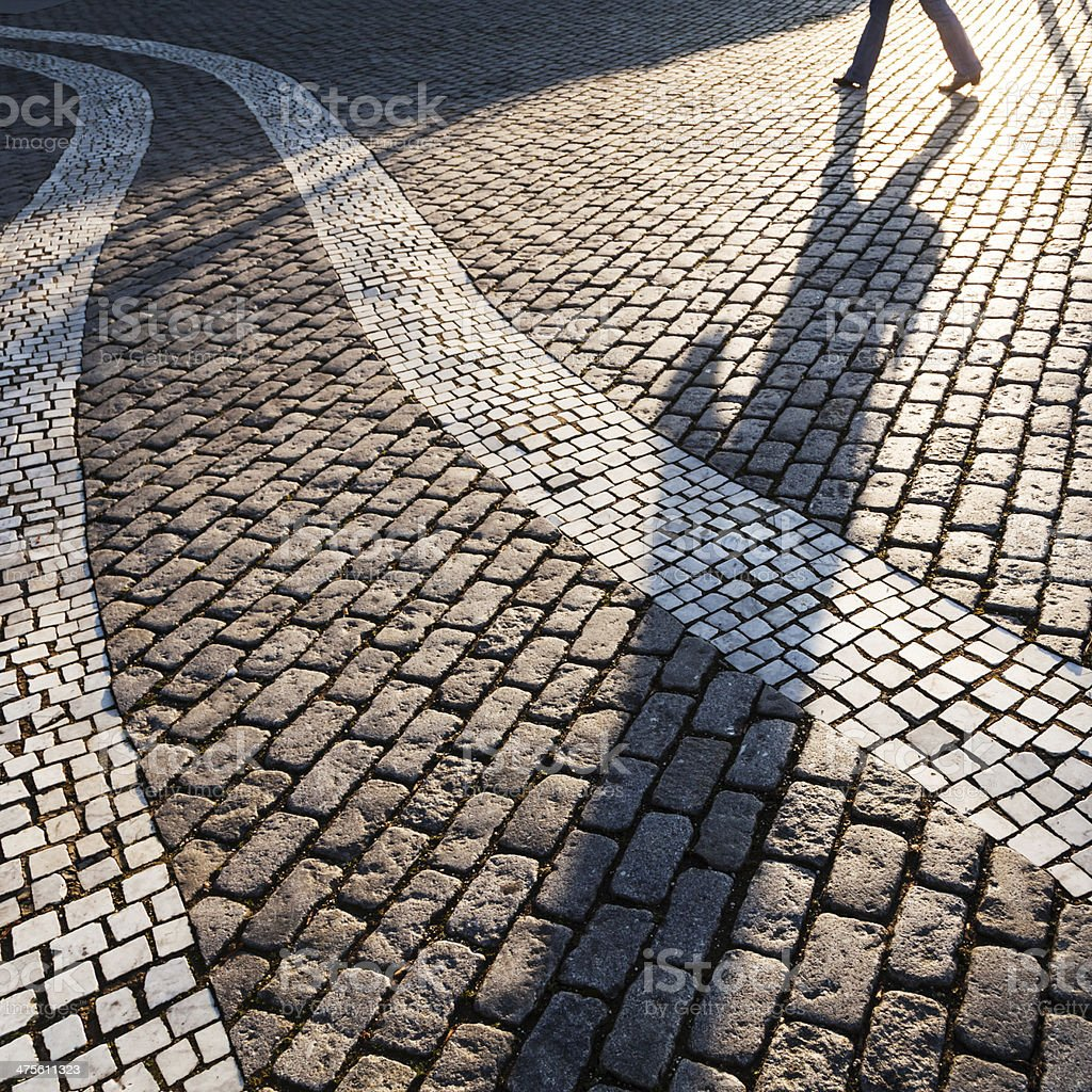 long shadow of a man stock photo