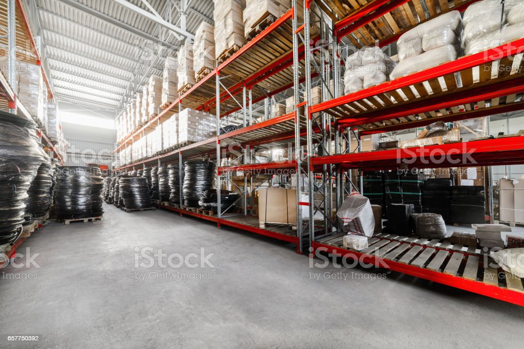 Long shelves with a variety of boxes and container stock photo