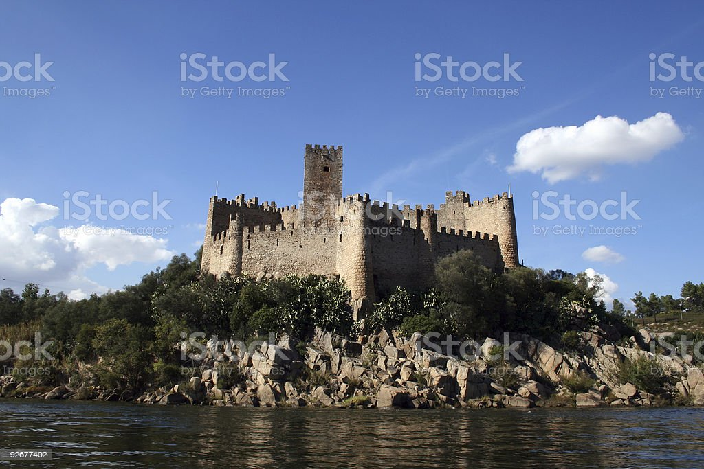 Long shot of Almourol castle from the lock stock photo