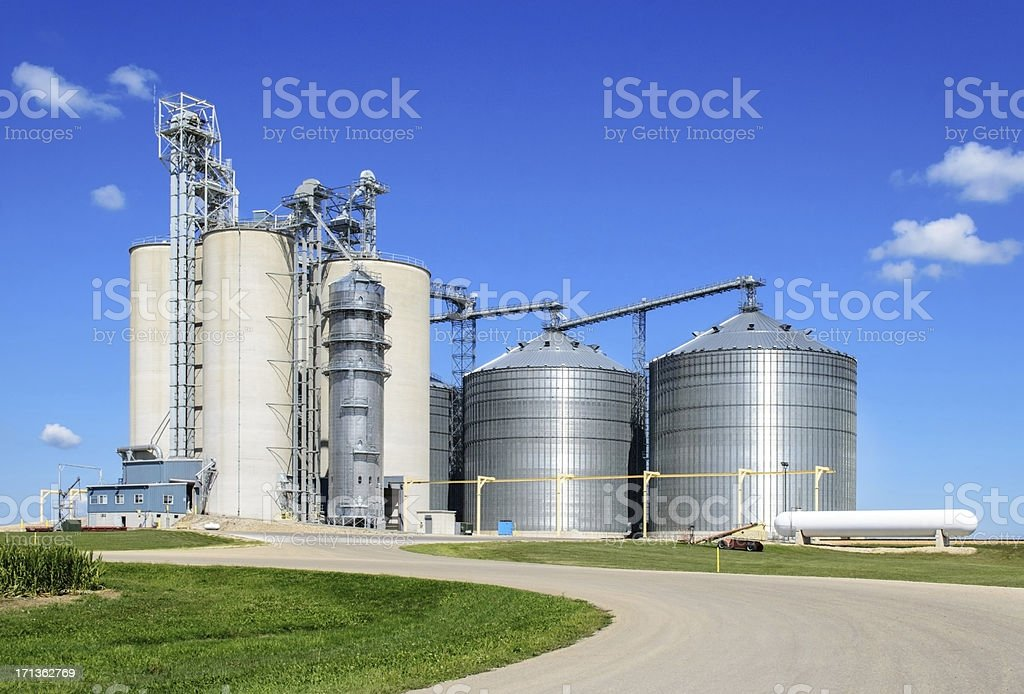 Long shot of grain elevator facility on a sunny day stock photo