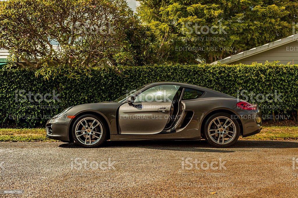 Long shot sideways. Porsche Cayman in residential area stock photo