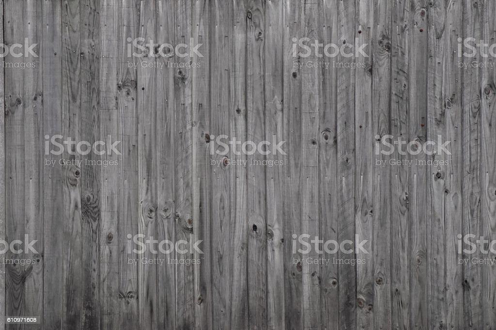 Long shot slatted wooden fence grey weathered stock photo