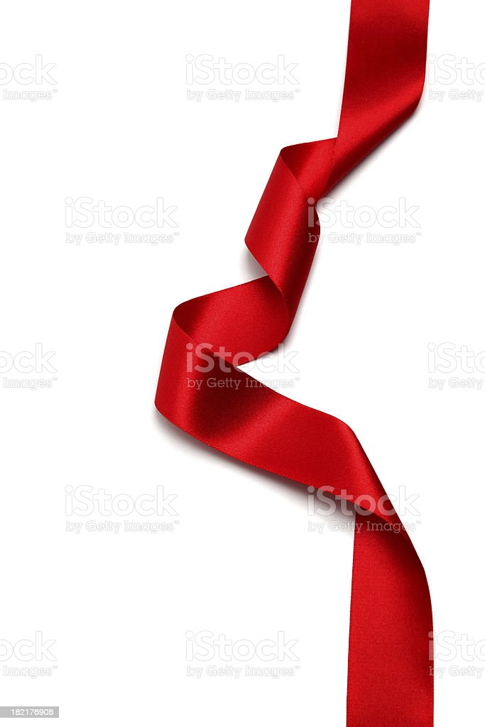 A long silk red ribbon against a white background stock photo