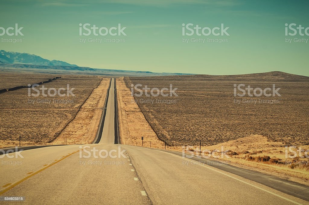 Long Straight Road in Wyoming USA stock photo