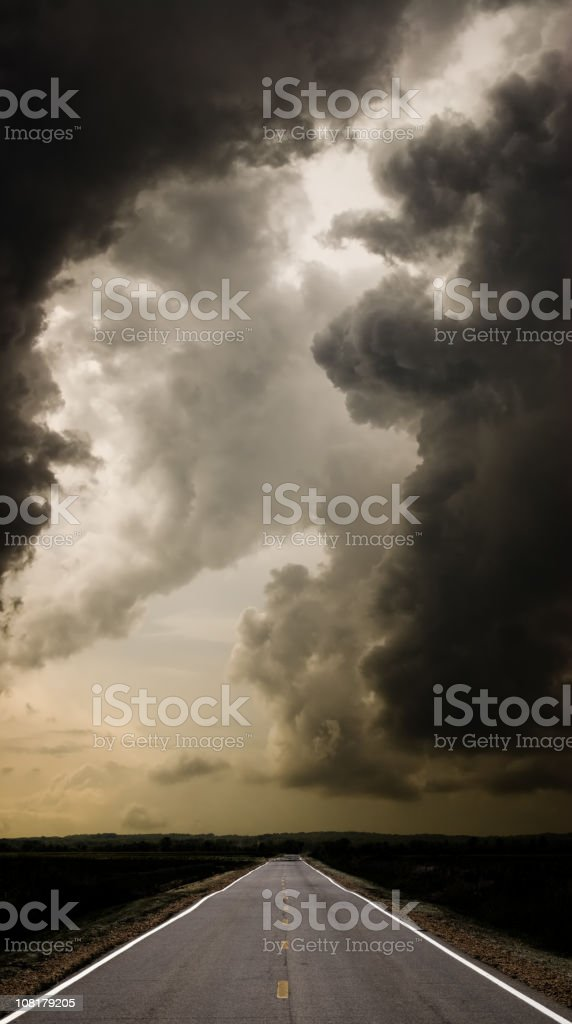 Long Straight Road Under Stormy Clouds royalty-free stock photo