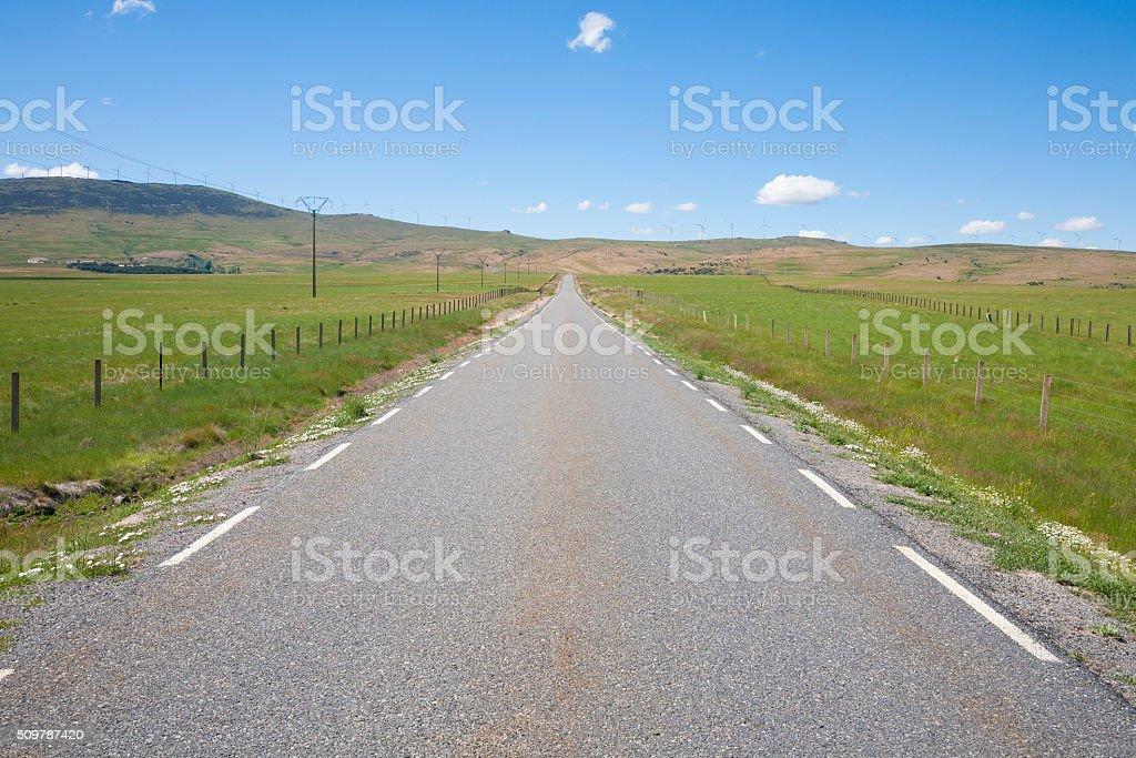 long straight rural road stock photo