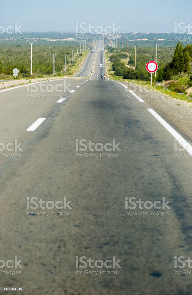 Long straight waved motorway in Morocco stock photo