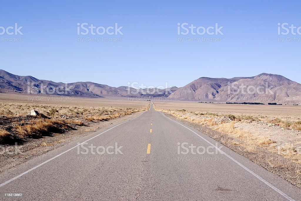 Long stretch of desert road stock photo