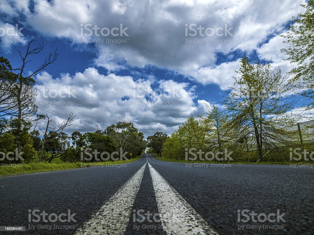 Long stretch of flat highway royalty-free stock photo