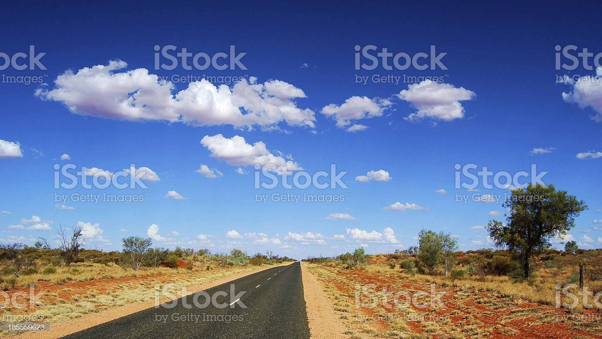A long stretch of road with vegetation at Outback, Australia royalty-free stock photo