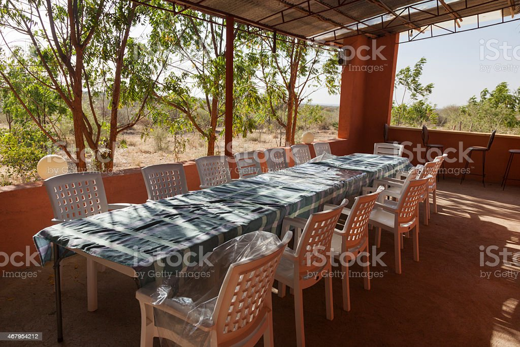 Long table and chairs on veranda. Turmi. Ethiopia. Africa. stock photo