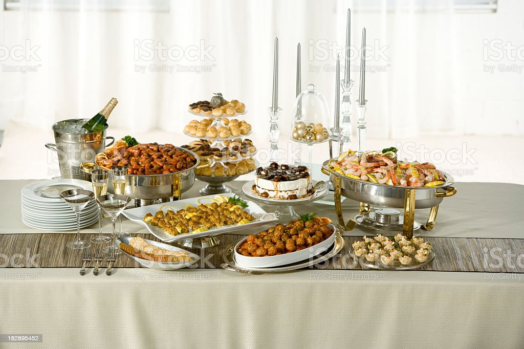 Long table with holiday buffet served stock photo