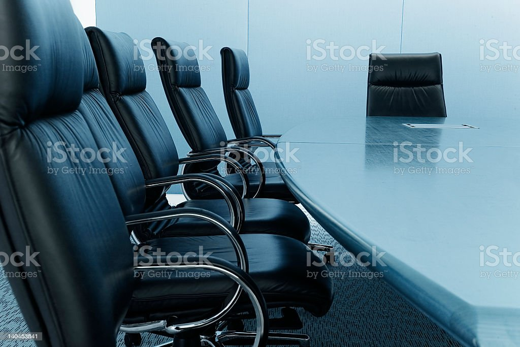 Long table with leather chairs in a meeting room royalty-free stock photo