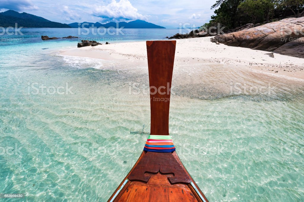 Long tail boat against blue sky and sea. Koh Rok island, Krabi, Thailand. stock photo