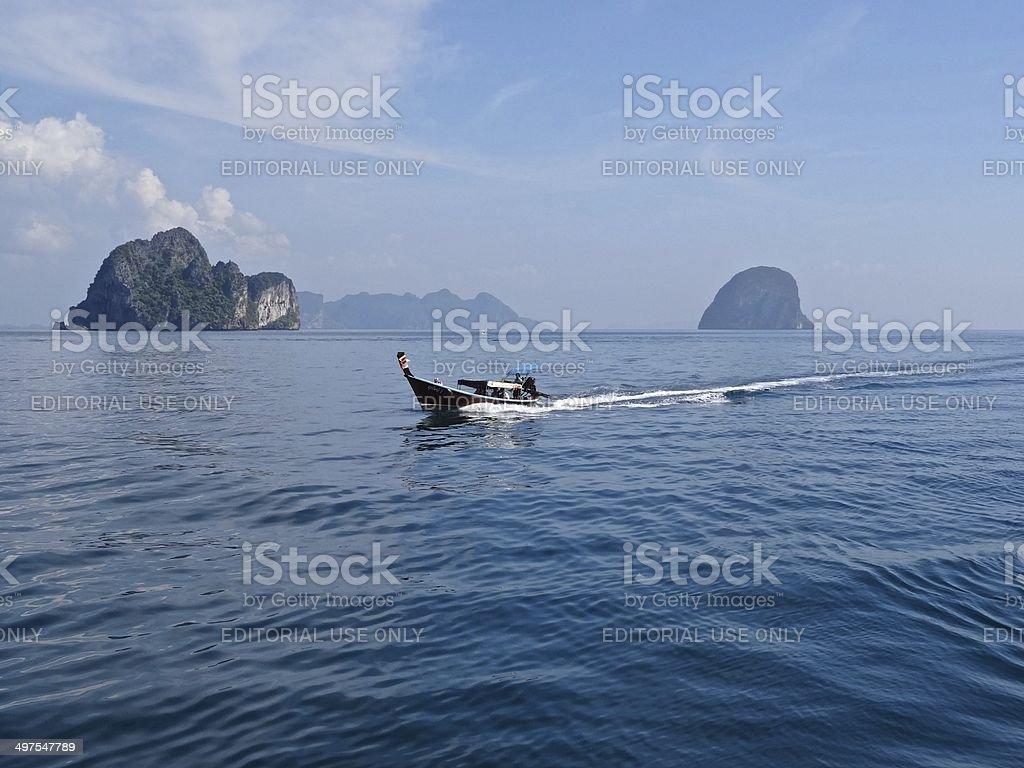 Long tail boat and karsts, Andaman Sea, Thailand royalty-free stock photo