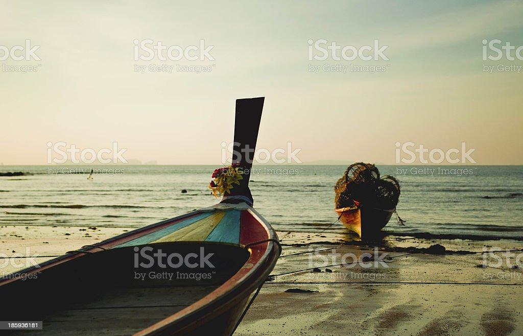 long tail boat at sunset royalty-free stock photo