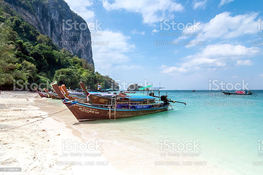 Long tail boat on tropical beach stock photo