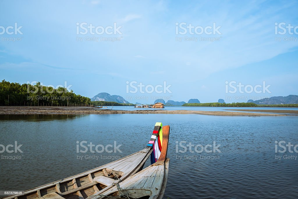 long tail boat , Port of mangrove forest in the countryside stock photo