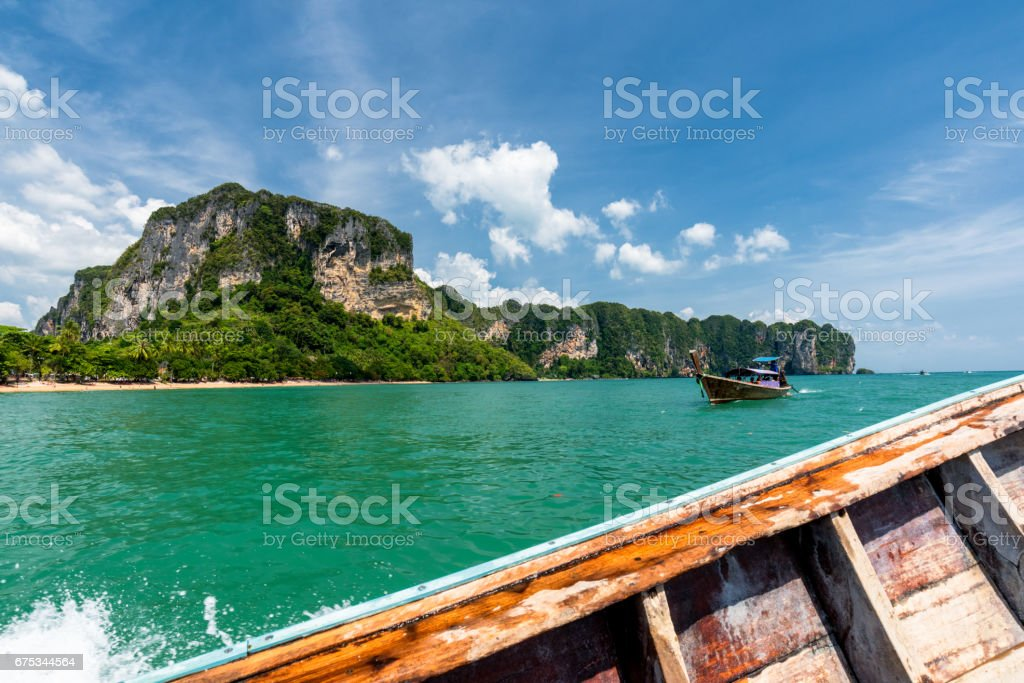 Long tail boat was sailing in Andaman sea from Ao Nang to Railay at Krabi, Thailand,Ao Nang and Railay popular tourism location in Krabi, Thailand,Beautiful beach with clear sea water and blue sky. stock photo