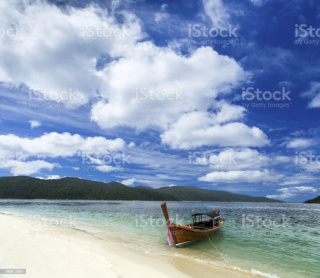 Long tail boat with blue sky background royalty-free stock photo