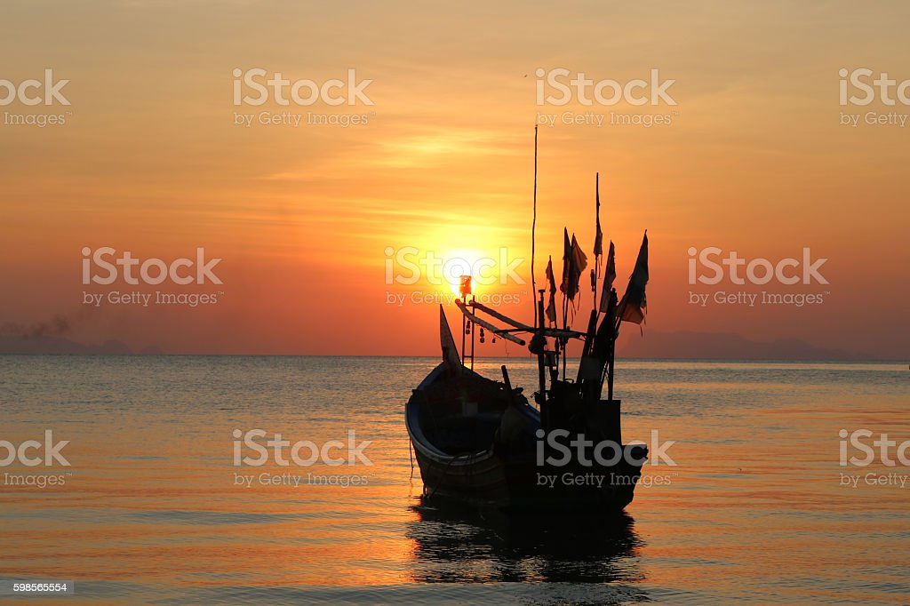 long tail boat with sunset in Thailand. stock photo
